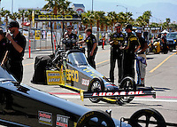 Mar 28, 2014; Las Vegas, NV, USA; The crew members for NHRA top fuel dragster driver Richie Crampton during qualifying for the Summitracing.com Nationals at The Strip at Las Vegas Motor Speedway. Mandatory Credit: Mark J. Rebilas-