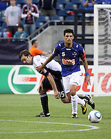 Cruzeiro midfielder Fabricio beats New England Revolution forward Zack Schilawski (15) to the ball.  Brazil's Cruzeiro beat the New England Revolution, 3-0 in a friendly match at Gillette Stadium on June 13, 2010