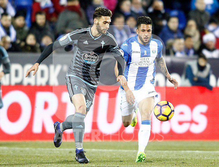 CD Leganes' Miguel Angel Guerrero (r) and Celta de Vigo's Sergi Gomez during La Liga match. January 28,2017. (ALTERPHOTOS/Acero)