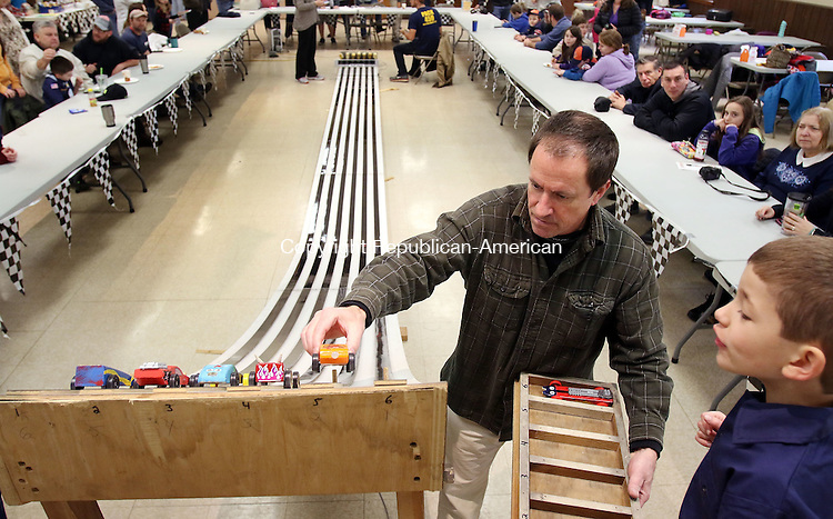 BETHLEHEM CT. 16 January 2015-011616SV01-From left, Peter Mahon of Bethlehem sets up the cars as Trevor Timko, 7, of Bethlehem watches during the Boy Scouts Pinewood Derby in Bethlehem Saturday.<br /> Steven Valenti Republican-American