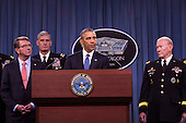 United States President Barack Obama delivers remarks after meeting with members of his national security team concerning ISIS at the Pentagon in Washington, D.C. on Monday, July 6, 2015. From left, Secretary of Defense Ashton Carter, Commander of U.S. Africa Command Gen. David Rodriguez, and Chairman of the Joint Chiefs of Staff U.S. Army General Martin Dempsey. <br /> Credit: Drew Angerer / Pool via CNP