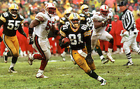"Desmond Howard returns a punt 71 yards for a touchdown during the NFC Divisional Playoff Game against the 49ers on January 4, 1997. Dubbed the ""Mud Bowl"", the Packers emerged the victor 35-14."