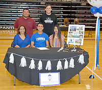 Graham Thomas/Siloam Sunday<br /> Siloam Springs senior midfielder Christian Marroquin signed a letter of intent Wednesday to play soccer at Crowder College in Neosho, Mo. Pictured are: Front from left, mother Elizabeth Marroquin, Christian Marroquin, sister Fernanda Marroquin; back, SSHS assistant coach Ehldane Labitad and head coach Luke Shoemaker.