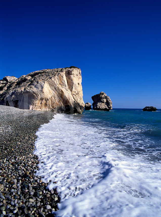 The pebbly beach and rocks on the coast at Petra Tou Romiou, birthplace of Afrodite in Cyprus