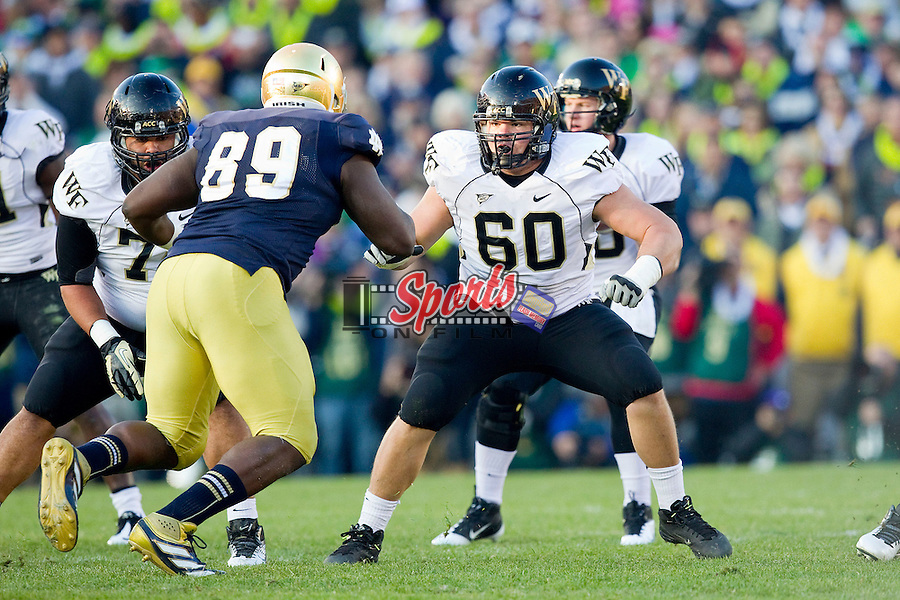 Whit Barnes (60) of the Wake Forest Demon Deacons during first half action against the Notre Dame Fighting Irish at Notre Dame Stadium on November 17, 2012 in South Bend, Indiana.  The Fighting Irish defeated the Demon Deacons 38-0.  (Brian Westerholt/Sports On Film)
