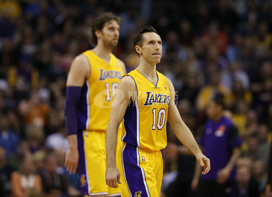 Jan. 30, 2013; Phoenix, AZ, USA: Los Angeles Lakers guard Steve Nash (10) and forward Pau Gasol against the Phoenix Suns at the US Airways Center. Mandatory Credit: Mark J. Rebilas-