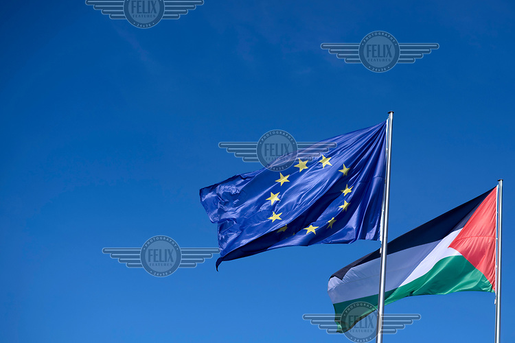 The European and Palestinian flags flying over the Chancellery during a visit by the Palestinian President Mahmoud Abbas.