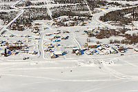 A team arrives off the Yukon River into the Nulato checkpoint on the afternoon of Sunday  March 15, 2015 during Iditarod 2015.  <br /> <br /> (C) Jeff Schultz/SchultzPhoto.com - ALL RIGHTS RESERVED<br />  DUPLICATION  PROHIBITED  WITHOUT  PERMISSION