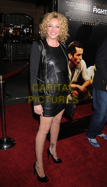 "VIRGINIA MADSEN .arriving at the Los Angeles premiere of ""The Fighter"" at Grauman's Chinese Theater in Hollywood, California, USA, December 6th, 2010..full length black leather dress jacket shoes clutch bag .CAP/ROT/TM.©TM/Roth Stock/Capital Pictures"