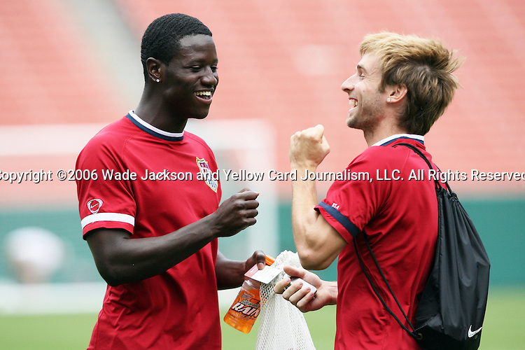 25 May 2006,  Eddie Johnson (L) and Bobby Convey (R) play a game of rock-paper-scissors after practice.  The USA Mens National soccer team held a practice session before taking on Venezuela in an international friendly match at Cleveland Browns Stadium in Cleveland, Ohio in their preparation for competition at World Cup 2006 in Germany.