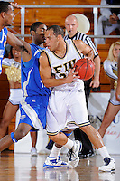 25 February 2010:  FIU's Marlon Bright (34) handles the ball in the first half as the Middle Tennessee Blue Raiders defeated the FIU Golden Panthers, 74-71, at the U.S. Century Bank Arena in Miami, Florida.