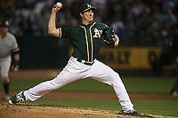 OAKLAND, CA - AUGUST 20:  Homer Bailey #15 of the Oakland Athletics pitches against the New York Yankees during the game at the Oakland Coliseum on Tuesday, August 20, 2019 in Oakland, California. (Photo by Brad Mangin)