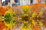 Overlooking The Pond in Central Park, Manhattan, New York City, on an autumn day. View towards Central Park South buildings with colorful autumn trees in the foreground.