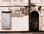 Derelict front of buidling with door and window