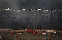 Pictured: Fresh produce is placed in front of riot police by the farmers Friday 12 February 2016<br /> Re: Violent clashes between farmers and riot police outside the Ministry of Agricultural Development in Athens, Greece. The farmers travelled from Crete to protest against pension and welfrae reforms proposed by the Greek government,