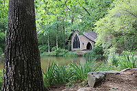 Elegant Gothic chapel nestled in woods in front of a quiet lake in Callaway Gardens, Georgia USA - Free Stock Photo.