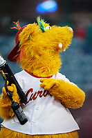 Altoona Curve mascot LoCo the Golden Locotami  shoots t-shirts into the stands during a game against the New Hampshire Fisher Cats on May 11, 2017 at Peoples Natural Gas Field in Altoona, Pennsylvania.  Altoona defeated New Hampshire 4-3.  (Mike Janes/Four Seam Images)