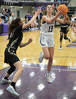 Fayetteville's Sasha Goforth (13) drives into the lane Friday, Jan. 17, 2020, as she is pressured by Emily Sanders Bentonville's Riley Hayes during the first half of play in Bulldog Arena in Fayetteville. Visit nwaonline.com/prepbball/ for a gallery from the games.<br /> (NWA Democrat-Gazette/Andy Shupe)