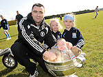 James, Jonah, Hayley and Chloe Hughes pictured with the Sam Maguire cup at Newtown Blues GAA club. Photo: Colin Bell/pressphotos.ie