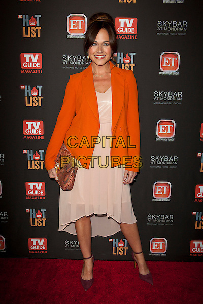 Nikki Deloach.TV Guide Magazine's 2012 Hot List Party held at SkyBar at the Mondrian, West Hollywood, California, USA..November 12th, 2012.full length dress clutch bag orange pink  blazer.CAP/ADM/ES.©Emiley Schweich/AdMedia/Capital Pictures.