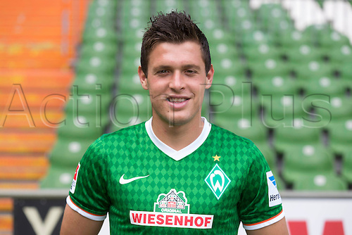 29.07.2013. Bremen, Germany.  The picture shows German Soccer Bundesliga club SV Werder Bremen's Zlatko Junuzovic during the official photocall for the season 2013-14 in Bremen.