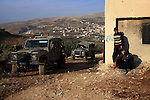 Israeli soldiers stand guard after the clashes between Jewish settlers and Palestinians in the West Bank village of Burin, near Nablus, Sunday, Jan. 2, 2011. Photo by Wagdi Eshtayah
