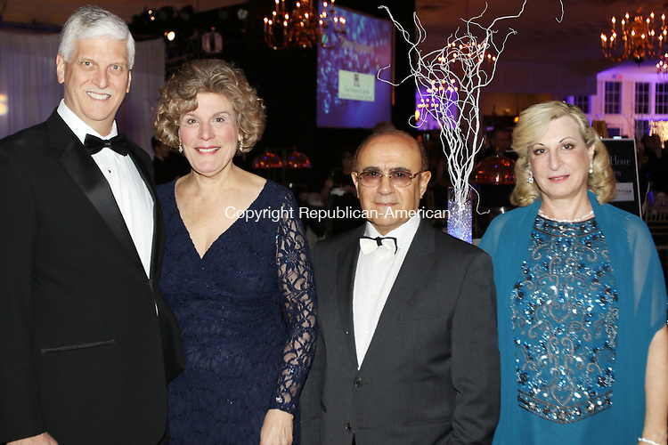 SOUTHINGTON CT. 06 February 2016-020616SV25-From left, Dr. William Frederick and Mary Frederick of Cheshire, and Dr. Aziz Richi and Dr. May Richi of Middlebury attend the Saint Mary's Hospital Foundation 25th Annual Gala at the Aqua Turf Club in Southington Saturday.<br /> Steven Valenti Republican-American