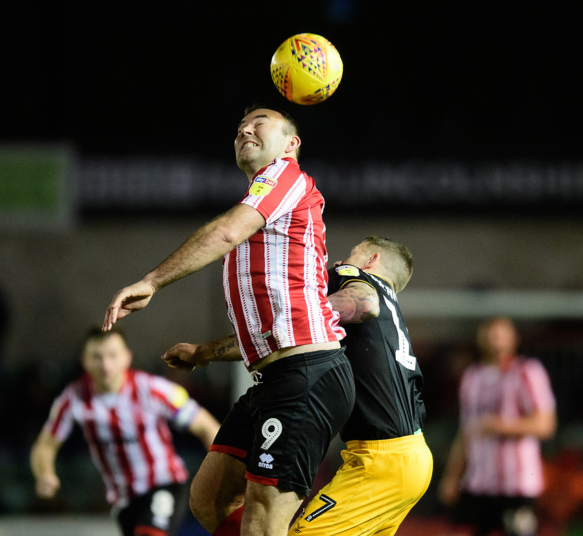 Lincoln City's Matt Rhead vies for possession with Newport County's Scot Bennett<br /> <br /> Photographer Chris Vaughan/CameraSport<br /> <br /> The EFL Sky Bet League Two - Lincoln City v Newport County - Saturday 22nd December 201 - Sincil Bank - Lincoln<br /> <br /> World Copyright © 2018 CameraSport. All rights reserved. 43 Linden Ave. Countesthorpe. Leicester. England. LE8 5PG - Tel: +44 (0) 116 277 4147 - admin@camerasport.com - www.camerasport.com
