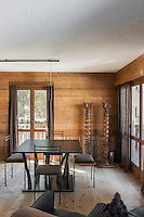 The focal point of the dining room is the unusual dining table by Giancarlo Candeago with its multitude of branch legs