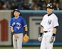 (L-R) Munenori Kawasaki (Blue Jays),Ichiro Suzuki (Yankees),.APRIL 26, 2013 - MLB :.shortstop Munenori Kawasaki of the Toronto Blue watches Ichiro Suzuki of the New York Yankees as he stands on second base during the baseball game at Yankee Stadium in The Bronx, New York, United States. (Photo by AFLO)
