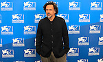 """Mexican director Alejandro Inarritu poses during the photocall of the movie """"Birdman or the Unexpected Virtue of Ignorance"""" presented in competition on the opening day of the 71st Venice Film Festival on August 27, 2014 at Venice Lido."""