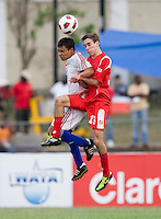 Brian Rosales (5) of Cuba goes up for a header against Francisco Narbon (13) of Panama during the group stage of the CONCACAF Men's Under 17 Championship at Jarrett Park in Montego Bay, Jamaica. Panama tied Cuba, 0-0.