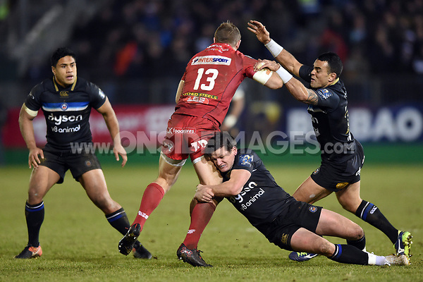 Freddie Burns of Bath Rugby tackles Hadleigh Parkes of the Scarlets. European Rugby Champions Cup match, between Bath Rugby and the Scarlets on January 12, 2018 at the Recreation Ground in Bath, England. Photo by: Patrick Khachfe / Onside Images