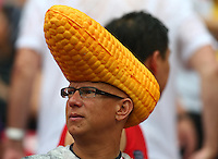 A supporter with a hat resembling corn on the cob