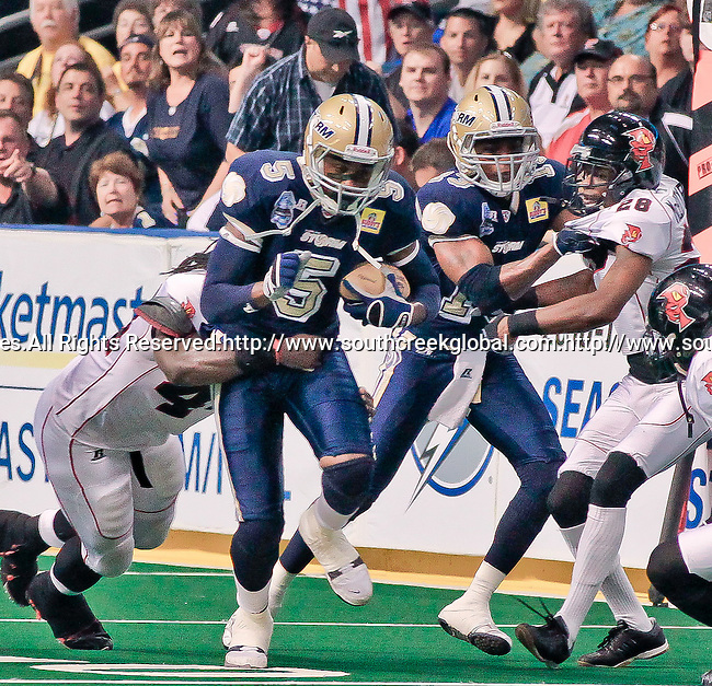 Aug 14, 2010: Tampa Bay Storm wide receiver Tyrone Timmons (#5) heads for the endzone. The Storm defeated the Predators 63-62 to win the division title at the St. Petersburg Times Forum in Tampa, Florida. (Mandatory Credit:  Margaret Bowles)