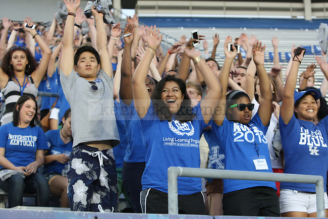 Students participate in the wave during Big Blue U at Commonwealth Stadium in Lexington , Ky., on Friday, August 23, 2013. Photo by Eleanor Hasken | Staff