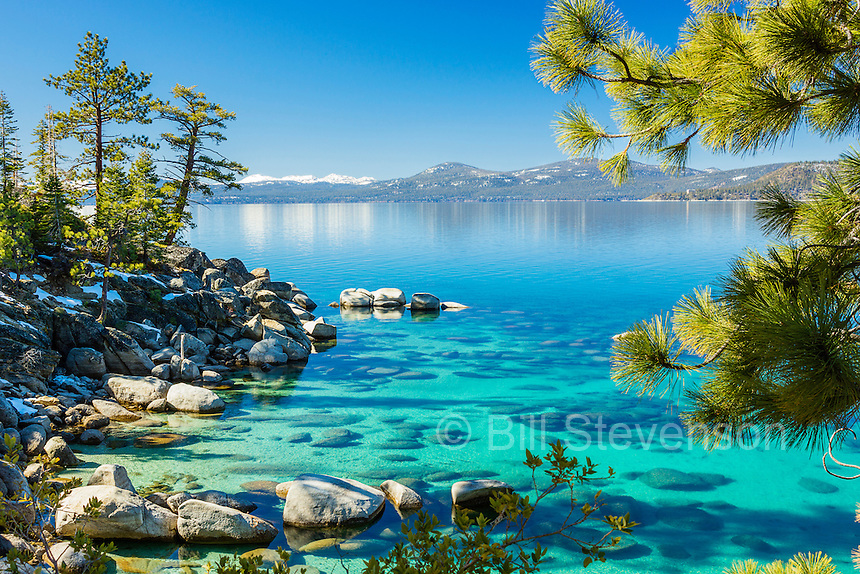 A beautiful spring day at Lake Tahoe. This spot is known to locals as Stony Point. Here the water is shallow and when the sun is high in the sky the light shines through the clear water illuminating the sandy bottom. This is what creates the beautiful colors of Lake Tahoe.