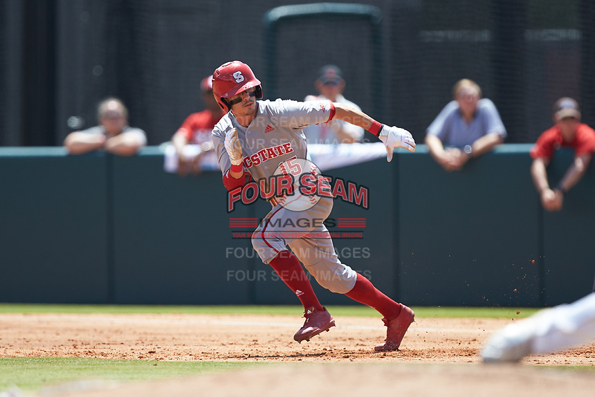Josh McLain (15) of the North Carolina State Wolfpack takes off for second base against the Northeastern Huskies at Doak Field at Dail Park on June 2, 2018 in Raleigh, North Carolina. The Wolfpack defeated the Huskies 9-2. (Brian Westerholt/Four Seam Images)