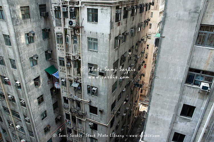 Old, run-down concrete high-rise apartment buildings in Kowloon, Hong Kong, China.