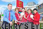 Dermot Hannigan manager of Murphy's Super Valu Kenmare cracks open the champagne to celebrate the shop selling the half million Euro Lotto winning ticket in last Friday nights draw