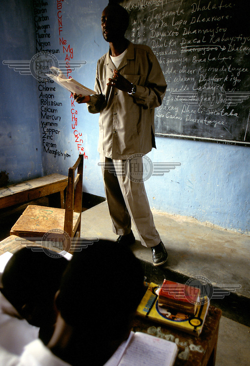 A teacher takes a lesson in a school classroom in the capital city.