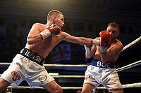 Liam Walsh (white/black shorts) defeats Maxi Hughes during a Boxing Show at York Hall on 9th November 2019