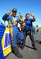 May 21, 2017; Topeka, KS, USA; NHRA funny car driver Ron Capps (left) is photo bombed by National Dragster photographer Marc Gewertz as he celebrates after winning his fourth straight victory following the Heartland Nationals at Heartland Park Topeka. Mandatory Credit: Mark J. Rebilas-USA TODAY Sports