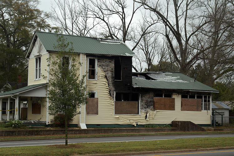 A historic house in DeFuniak Springs was destoyed by fire after being restored for use as offices.  The excellent restoration is visible at the front of the house with the destruction and melted vinyl siding visible at the back.