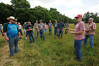 NWA Democrat-Gazette/ANDY SHUPE<br /> Ken Coffey (right), co-owner of a sheep and goat farm west of Prairie Grove, speaks Wednesday, June 14, 2017, about forage crops to a group of veterans participating in the National Center for Appropriate Technology's Armed to Farm program during a tour of Coffey's farm.
