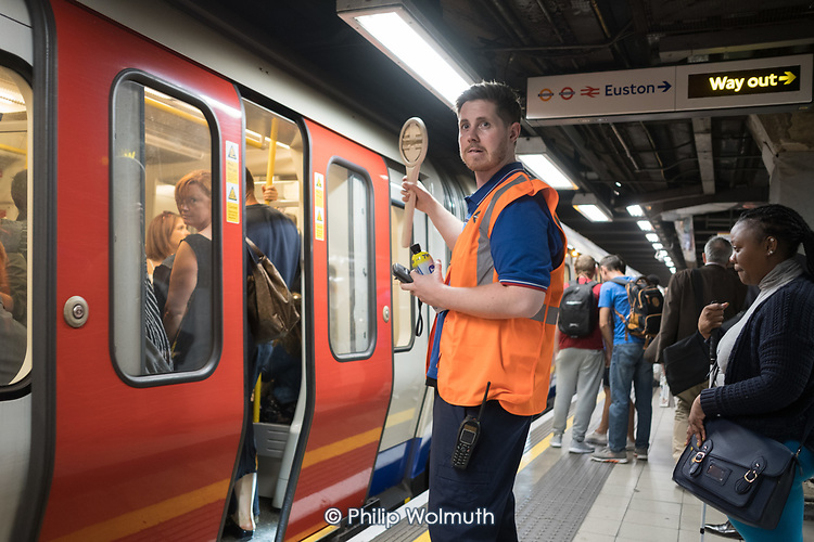 London Underground train guard at Euston Square tube station.