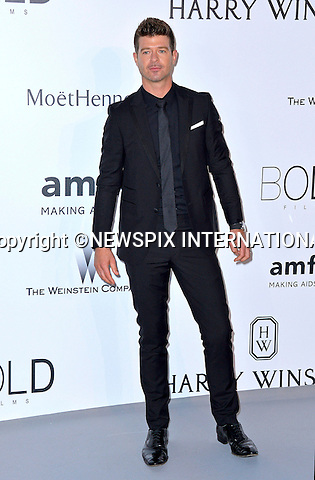 12.05.2015, Antibes; France:ROBIN THICKE<br /> attends the Cinema Against AIDS amfAR gala 2015 held at the Hotel du Cap, Eden Roc in Cap d'Antibes.<br /> MANDATORY PHOTO CREDIT: &copy;Thibault Daliphard/NEWSPIX INTERNATIONAL<br /> <br /> (Failure to credit will incur a surcharge of 100% of reproduction fees)<br /> <br /> **ALL FEES PAYABLE TO: &quot;NEWSPIX  INTERNATIONAL&quot;**<br /> <br /> Newspix International, 31 Chinnery Hill, Bishop's Stortford, ENGLAND CM23 3PS<br /> Tel:+441279 324672<br /> Fax: +441279656877<br /> Mobile:  07775681153<br /> e-mail: info@newspixinternational.co.uk