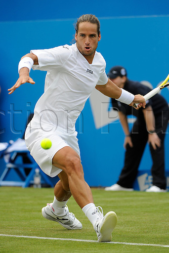 07.06.2011 The AEGON Championships from Queens Club in London. Feliciano Lopez of Spain returns a shot in his match against Andy Roddick of the USA on day two of the Aegon Championships at the Queen's Club.