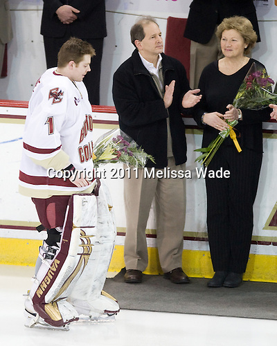 John Muse (BC - 1), Laurence Greenberg, Deborah Greenberg, - The Boston College Eagles defeated the visiting University of New Hampshire Wildcats 4-0 while celebrating senior night on Friday, March 4, 2011, at Conte Forum in Chestnut Hill, Massachusetts.