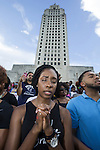 BATON ROUGE, LA - JULY 09: Kali Johnson joins the prayer at the Louisiana Capitol after protesters marched on the Capitol to protest the shooting of Alton Sterling on July 9, 2016 in Baton Rouge, Louisiana. Alton Sterling was shot by a police officer in front of the Triple S Food Mart in Baton Rouge on July 5th, leading the Department of Justice to open a civil rights investigation. (Photo by Mark Wallheiser/Getty Images)